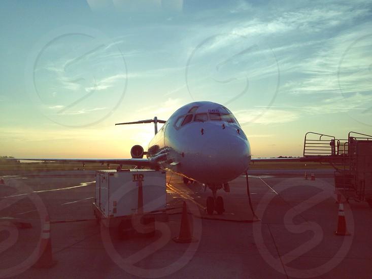 lather near airplane photo