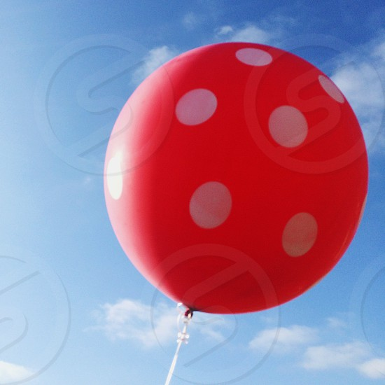 red and white polka dot balloon photo
