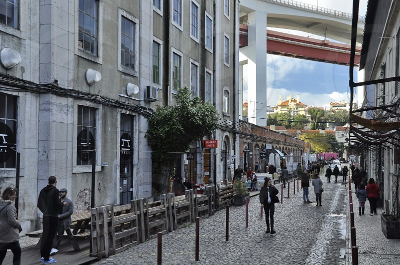 Lisbon Portugal - December 29 2017: View of the Rua Rodrigues de Faria in the LX Factory community space under the 25th of April Bridge photo