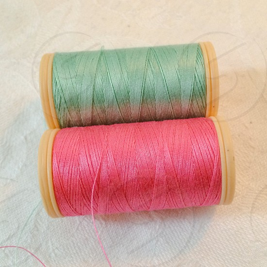 pink and green thread rolls photo