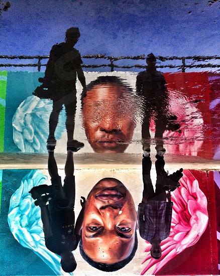 Graffiti people reflex water urban city street art wall art photo