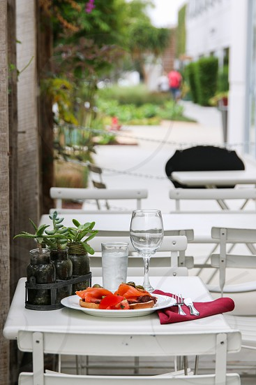 Bagel and salmon on the patio photo