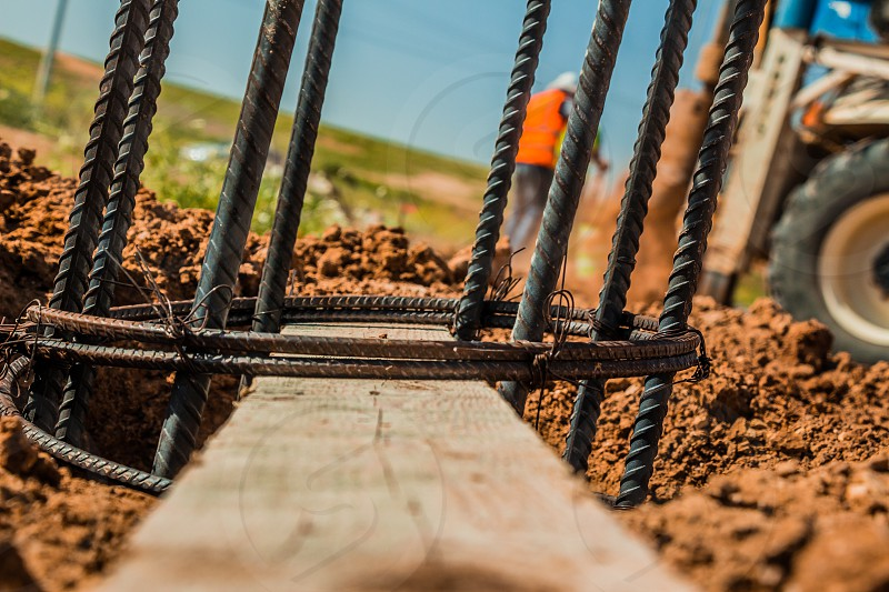 Steel rod used for poles construction with reinforce concrete in a hole in the ground at construction site. photo