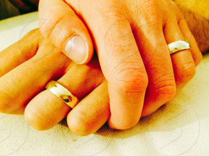 human hands with wedding rings photo