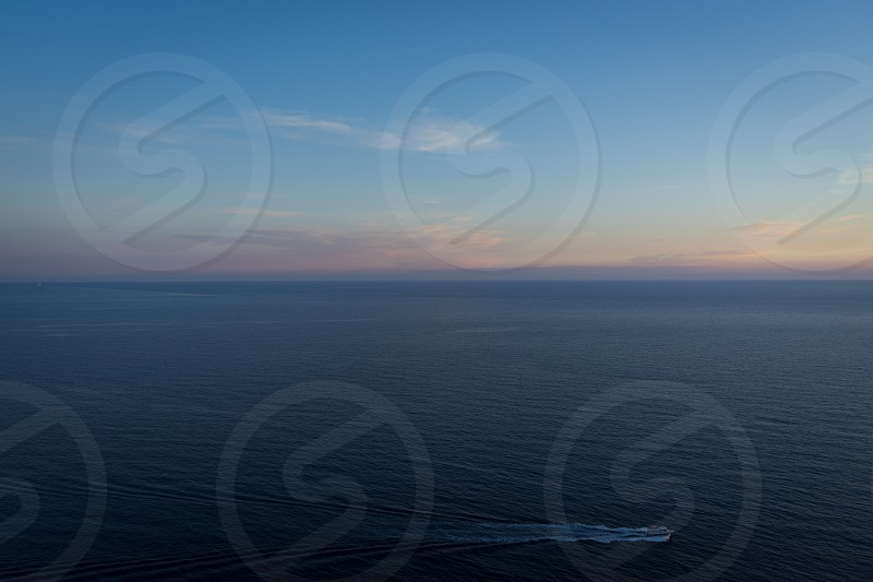 A lonely fishing boat in the big ocean. photo