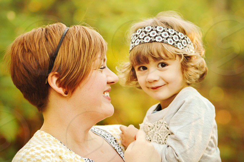 woman carrying girl smiling photo photo
