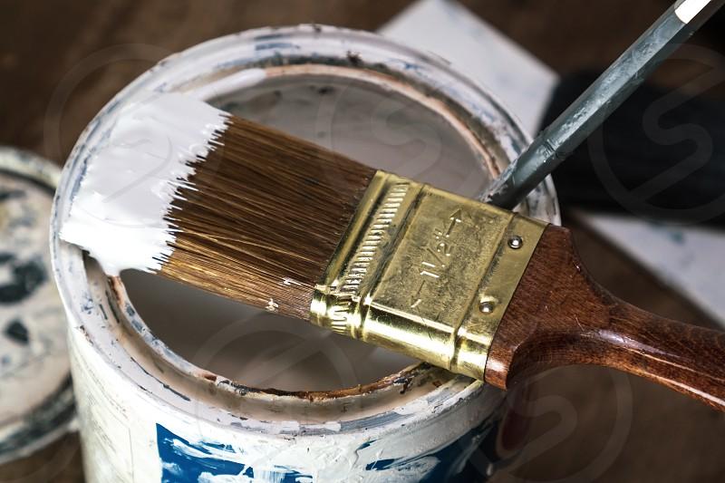 Paint brush with white paint photo