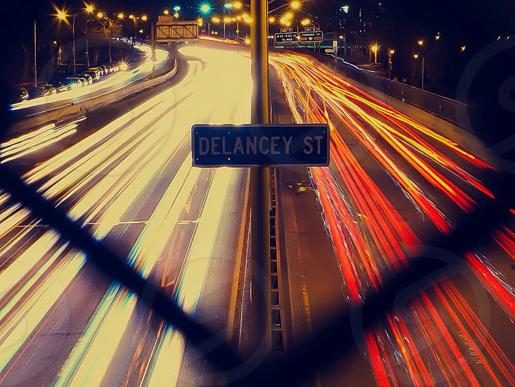 delancey st street sign with light long exposure viwe photo