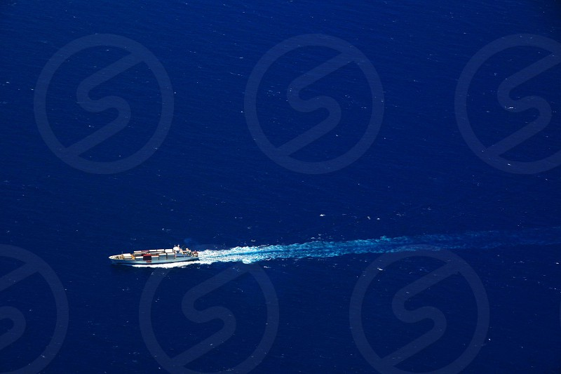 white speedboat on blue water photo