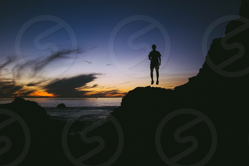 outdoor view of jumping man's silhouette photo