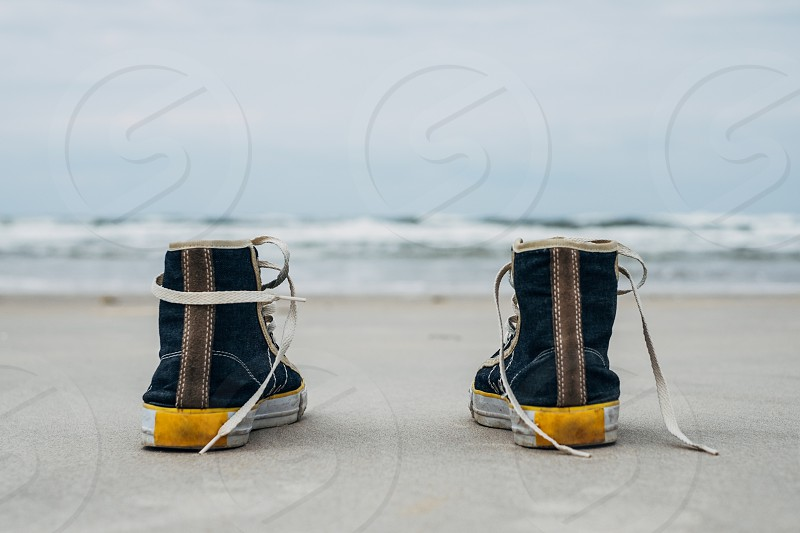sneakers on the beach photo