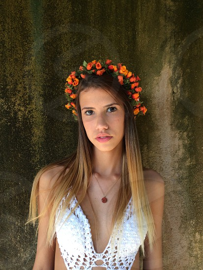 woman with long straight hair with orange flower crown photo