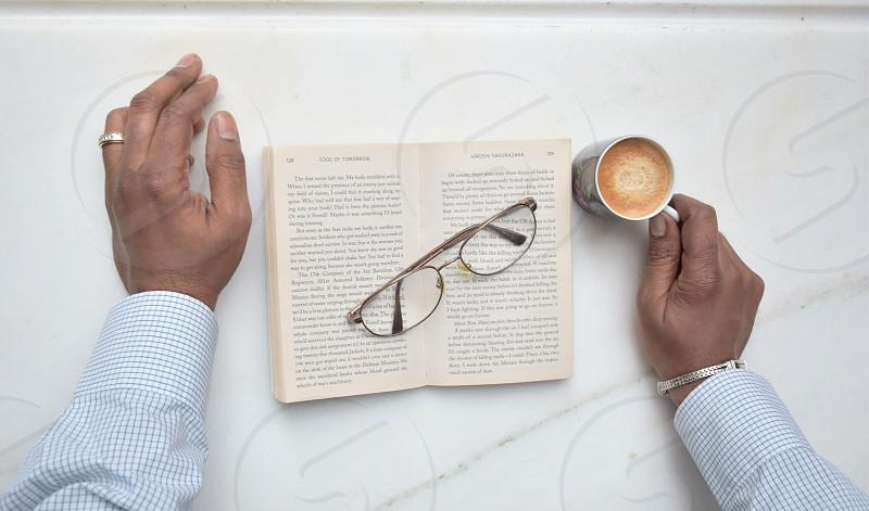 brown framed eyeglasses on brown book photo