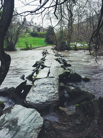 tarr steps over the river exe in exmoor  photo