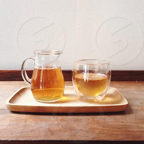 clear glass mug on brown tray photo