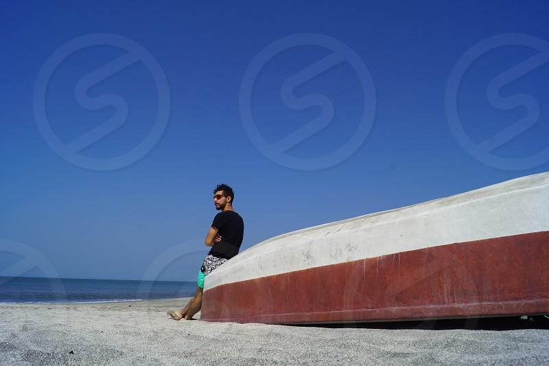 Man on the beach.  Santa Marta Colombia photo