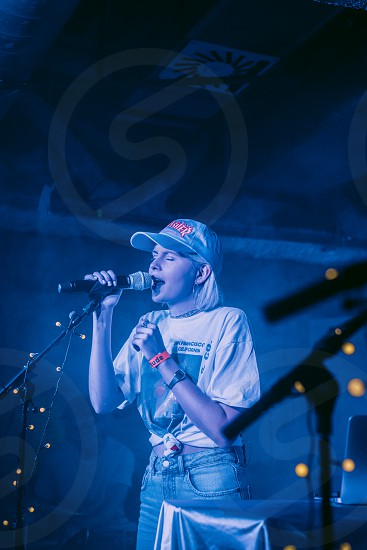 Young female lead singer performing on a podium in a club.  Tolstoys. photo