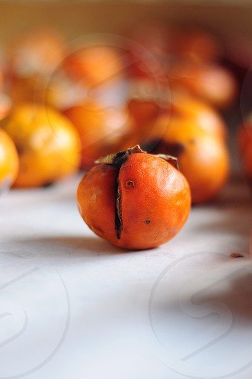 close up photography of persimmon fruit photo