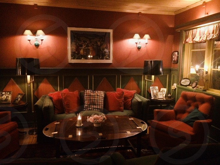 Sitting area in akerblad's guesthouse and hotel tallberg Sweden. Dark red interior cosy photo
