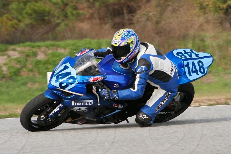 sportbike leaning turn blue fast photo