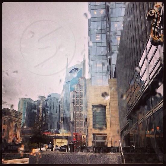 city streets seen through rain covered glass window photo