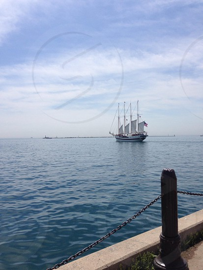 masted sailing ship in water photo