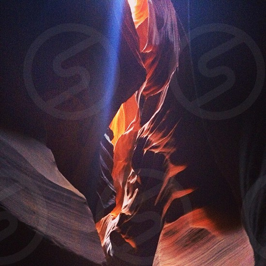 brown rock formation with light reflection photography  photo