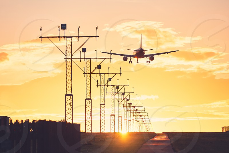 Airplane landing on the airport runway at the sunset. Prague Czech Republic photo