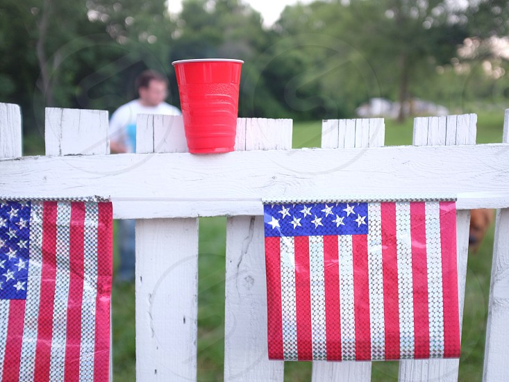 usa flag in the white wooden fence photo