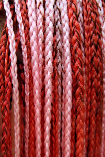 artificial colorful braided hair red and pink color photo