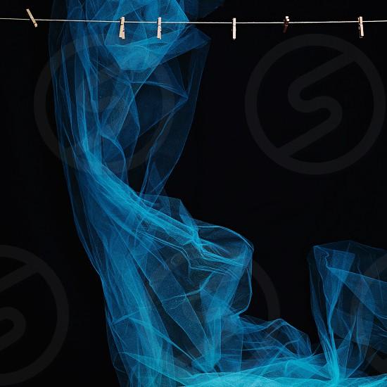 Taffeta blue flame effect artistic still life clothespin line string dramatic photo