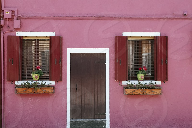 burano venice italy building pink red facade windows door shutters pink red photo