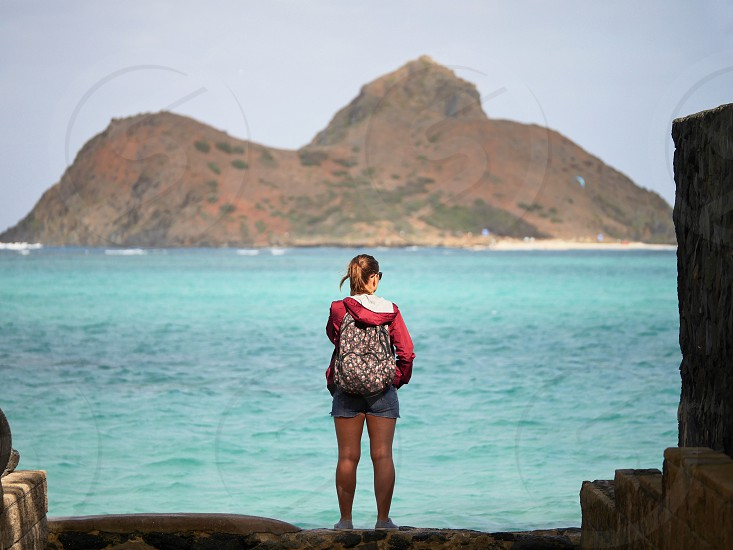 Woman standing in front of an island on the edge photo