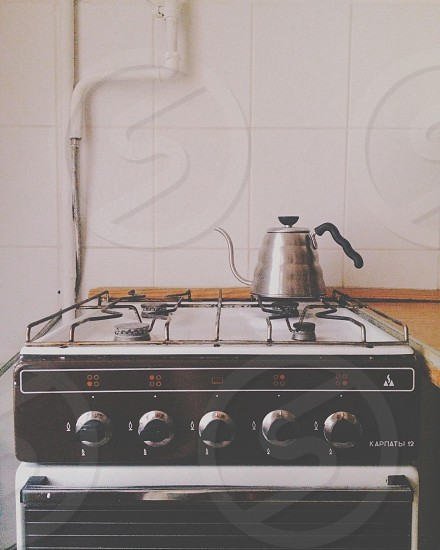 Old Russian stove and a Hario Buono Kettle. photo