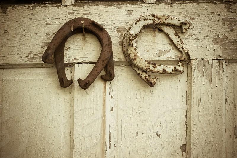 Horseshoes on a barn door. photo