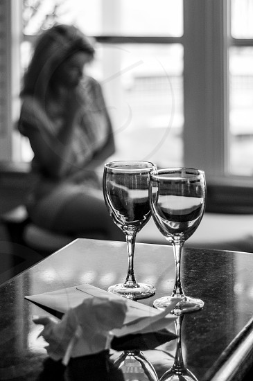 Love Sickness //#lady #girl #20's #staring out window #wine glasses #letter #sitting on bench photo