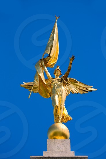 Gold winged Victory statue in World War I Memorial in Washington DC photo