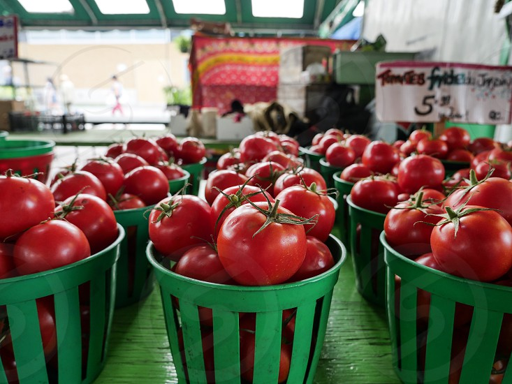 Fresh organic tomatoes at the Jean-Talon market in Montreal Quebec Canada healthy eating farmers market organic produce photo