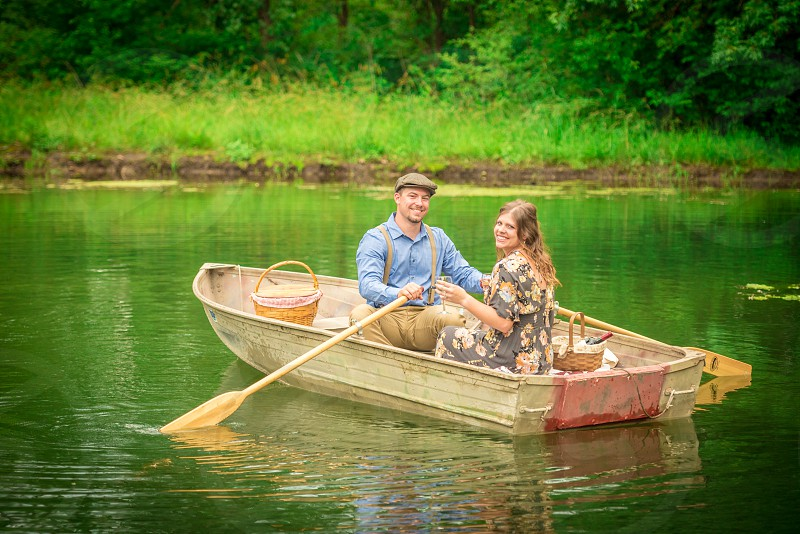 Young couple having a picnic in a boat. photo