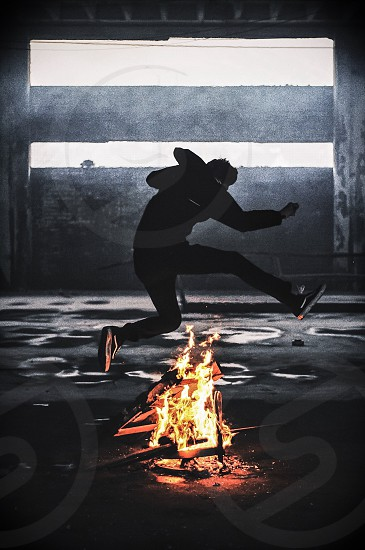 fun fire youth jumping jump orange explore danger young photo