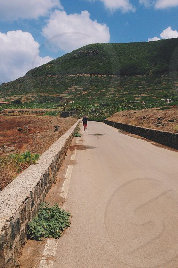 Island . Ustica . Road . Island . Summer  . Hills . Mountains . Open road photo