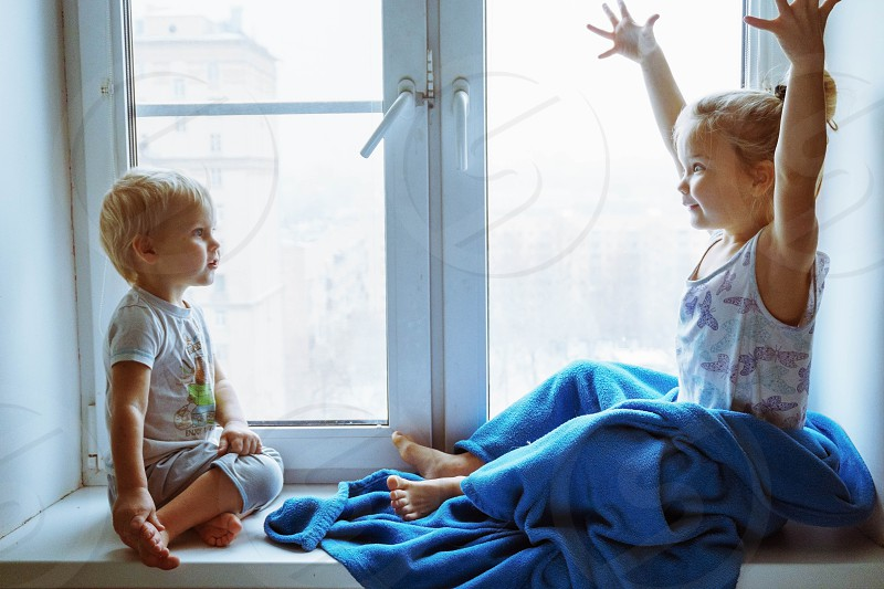 older sister telling story in Moscow Russia photo