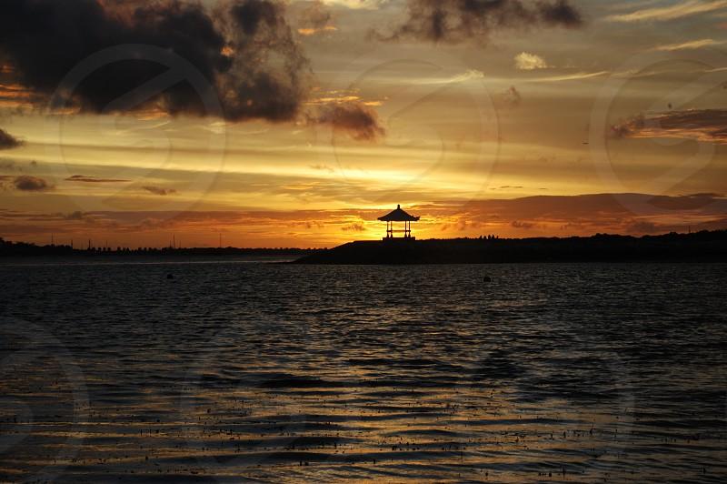 enjoy the sunset in Bali photo