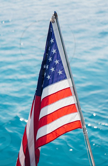american america flag ocean water summer independence day photo