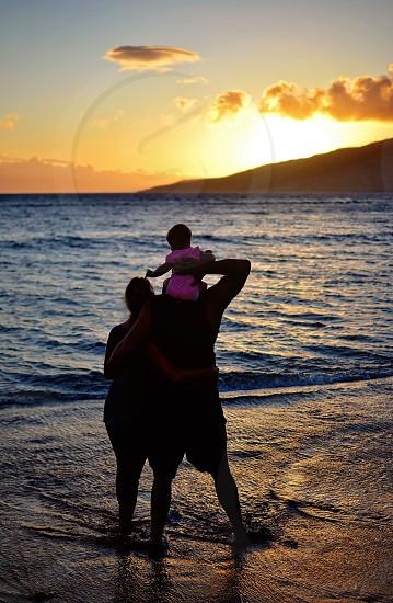 Family in Hawaii enjoying the beach photo