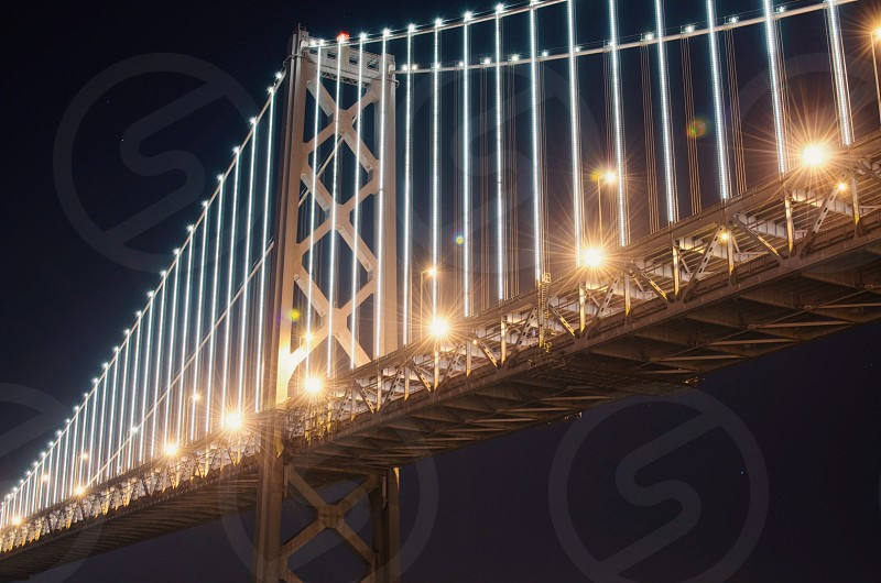 lighted oakland bay bridge photo