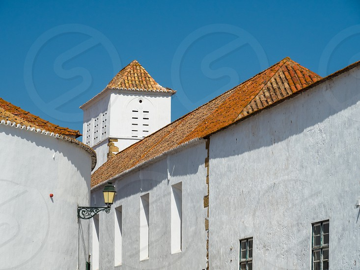 In the old alleyways of Faro on the coast of southern Portugal the capital of the Algarve district photo