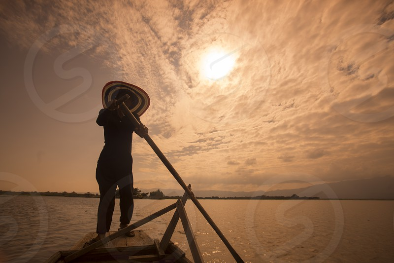 a rowingboat on the way to the wat Tiloke Aram Island at the lake of Kwan Phayao in the city of Phayao in North Thailand. photo