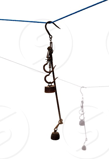 Antique scales rusted iron with weights on white with shadow photo