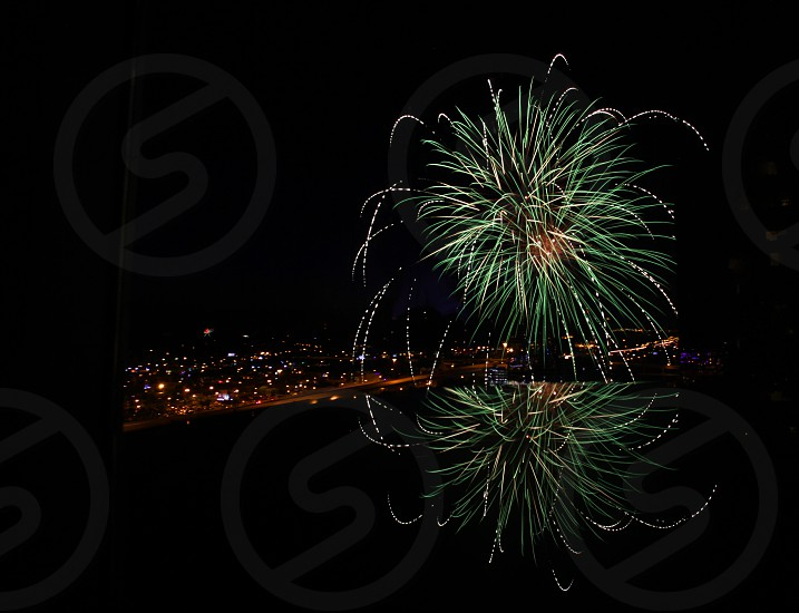 Firework reflected in water photo